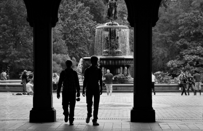 Silhouettes against Central Park fountain